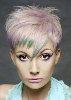 asymmetrical, edgy bangs,  violet highlights on silver hair, green color on bangs