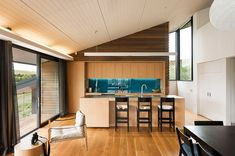 love the blue splashback with wood look