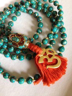 Turquoise OM mala with orange tassle and Tibetan guru bead on Etsy, Sold