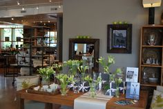 Lots of #Simon Pearce vases and lots of calla lilies to go with them!