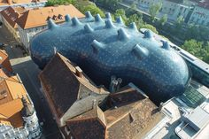 The historic center of the city of Graz is located on the River Mur in Austria is home to the Kunsthaus Graz, a building designed by Sir Peter Cook and Colin Fournier in 2003.