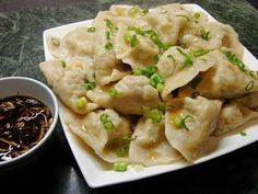 Chinese dumplings (Jiaozi). I love this website!  It gives a lot of the translations too.