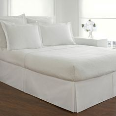 Available in black, burgundy, denim blue, ivory, mocha, navy blue, sage, taupe or white, t his elegant bedskirt adds a finishing touch to any bedroom. Featuring a delicately tailored cotton blend cons
