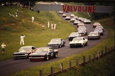Mid-Ohio, 1969 TransAm Series. Mark Donahue on the pole in the Sunoco Camaro (6) with Parnelli Jones alongside in a Ford Mustang (15). Second row: Milt Minter in a Pontiac TransAm (11) and Peter Revson in a Shelby Mustang (1).