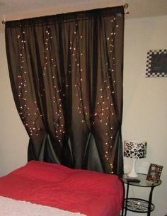 White String Lights behind a Black (dark colored) Sheer Curtain to creat a modern, dramatic Headboard
