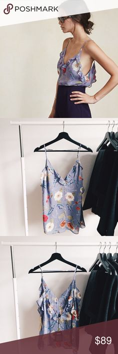 """ʀᴇғᴏʀᴍᴀᴛɪᴏɴ ᴄʜᴀᴍʙᴇʀ ᴛᴀɴᴋ Gorgeous NWT sold out floral chamber tank from Reformation. Perfect blouse that is light-weight, flowy, and sheer. Very easy to dress up or down for any occasion. Loose fitting, ruffled v-neck, and also a low v-cut on the back of the shirt. Straps are also adjustable.   ‣100% ᴠɪsᴄᴏsᴇ ‣ʙᴜsᴛ: 39""""  ✨Pet friendly home ✨Please feel free to ask any questions! ✨Reasonable offers are welcomed ✨Bundle to save more- Make an offer on your bundle! Reformation Tops Blouses"""