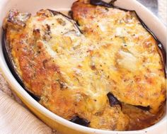 This cheesy Twice Baked Eggplant reminds me of a healthy twice baked potato. These cheese stuffed eggplant skins are so creamy and delicious, they'll make an eggplant lover out of anyone! Baked Eggplant, Eggplant Recipes, Stuffed Eggplant, Bbq Baby Back Ribs, Twice Baked Potatoes, Tasty, Yummy Food, Kitchen Dishes, Gourmet