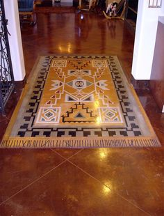 After building an addition to his home, the client wanted a design to tie the old space to the new. The team at Surface Gel Tek came up with a Southwestern rug design, which was put down with a stenciling system designed to be installed over concrete floors.