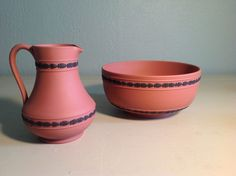 Wedgwood terra cotta and black jasperware pitcher and bowl. Picher 6 inches tall. Bowl 7 3/4 inches in diameter.l