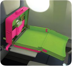 We so need this for the little one! No more struggling to reach the tray table to color while staying buckled in
