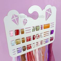 DIY Kite Ribbon Storage Hanger - might be good for Poppy's hair ribbons?