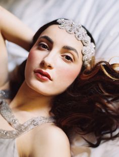 Photography Laura Gordon l Gramercy Park Hotel l Daleesa Weary, Hairstylist l Carl Ray Makeup Artist l Gowns by Lazaro l Gowns by Gossamer l Cake & Sugar Flower Halo by Maggie Austin Cake l Chocolates by Bissinger's Handcrafted Chocolatier l Model Kristina Bordyugova l Headpieces by Enchanted Atelier by Liv Hart and LIV HART for Sophie Hallette