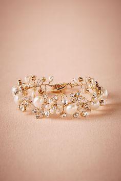 Bridesmaid Bracelet: handmade with gold plated zinc, glass stones and freshwater pearls, toggle closure. A stunning add-on to your wrist as well as the whole wedding look.