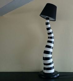 Add a bit of Tim Burton-style ambiance to your room with these curvy Beetlejuice lamps. Etsy shop Omulamp hand makes the striped lamps from paper covering a mold made with resin and foam so the lamp . Gothic Furniture, Funky Furniture, Beetlejuice Halloween, Beetlejuice House, Tim Burton Style, Tim Burton House, Horror Decor, Goth Home, Backyard Camping