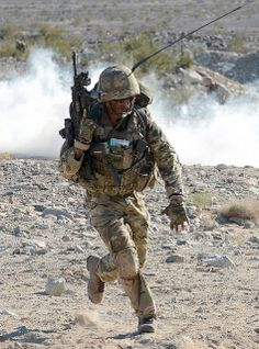 A Royal Marine with 40 Commando Group runs across the barren landscape of Mojave Desert in California, USA during Exercise Black Alligator.
