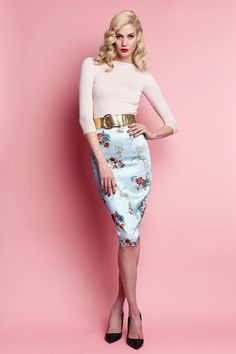 <div>Presenting this season's most lust worthy piece, the Mayfair Affair printed Le Chic Pencil Skirt! Duck-egg blue with hints of rouge and rose, featuring antique florals and fauna in autumnal shades. Delicate peacocks perched upon ornamental filigree and delicate latticework are also inherent in this charming design. Constructed in our opulent imported stretch matte satin to envelope your curves in a firm and sleek fit. Other features include a shapely waistband detail, ce…