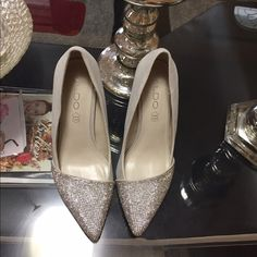 ALDO -rhinestone-adorned pumps.Pointy toe. Material: Textile.Sole: Textile.rhinestone-adorned pumps.- Single sole.Pointy toe.g. - Heel height: 4 in.pre-owned.used once.good condition .are not dirty, no scratches.no box ALDO Shoes Heels