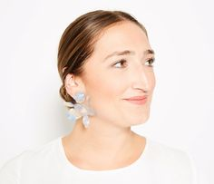 Lele Sadoughi flower earrings and Charlotte Tilbury pink lipstick - click ahead for more holiday lipstick and earring pairings