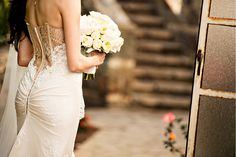 Details » laurie bailey photography // Back detail shot of the wedding dress and bouquet.