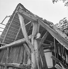 Dutch barn - The large beam with a tenon protruding through the post is called an anchor beam. This image is of a barn in the Netherlands, but anchor beams in North America are very similar. (Nutter - 20170459 - RCE)