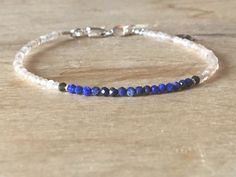 A personal favourite from my Etsy shop https://www.etsy.com/no-en/listing/601556119/lapis-lazuli-and-grey-moonstone-bracelet