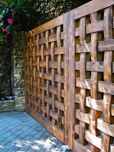 Such a good looking and substantial fence - Woven wood. Pinned to Garden Design - Walls, Fences & Screens by BASK Landscape Design.