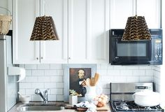 Feather covered lampshades conceal unattractive pendants!