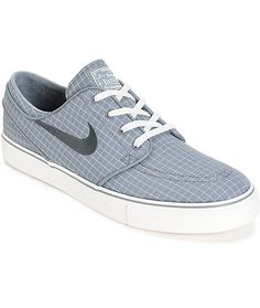 quality design ee735 c3c64 Update your shoe game with an all over Cool Grey and Sail square print  canvas upper and a Nike Zoom Air insole with heel air pockets for  comfortable impact ...