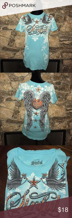 Women's Sinful T-shirt Turquoise short sleeve sinful t-shirt with orange rhinestones. There is a small hole near the right sleeve Sinful Tops Tees - Short Sleeve