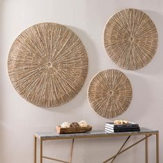 Bursting with boho design, this three-piece, seagrass wall decor set adds dimension to your space. Woven sunburst patterns radiate across each round wall sculpture. For a year-long taste of summer, cluster the trio together over your e Dining Room Wall Decor, Wall Decor Set, Wall Art Sets, Bedroom Decor, Large Wall Art, Diy Wall, Baskets On Wall, Decorative Wall Baskets, Boho Living Room