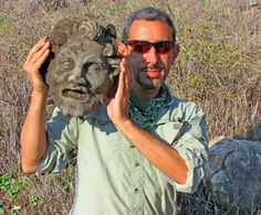 University of Haifa archaeologist with the bronze mask of Pan. Image credit: Michael Eisenberg.