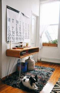 retro console table, baskets, furry rug
