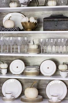 Simple fall decorating of china cabinet shelves with white pumpkins