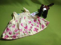 Blusón de flores, marca Baby Headquarters, 3-6 meses, Q25.00