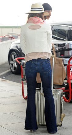 Smiling brightly, actress Jessica Alba wore the J Brand Kiki High-rise Flare Leg jeans in Monaco while catching a flight out of London's Heathrow airport...