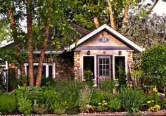 This is not my front view but that of a house for sale in NYC for 279K... This and the pics that follow can be found at http://inhabitat.com/nyc/green-country-cottage-for-sale-just-north-of-nyc-in-suffern-ny/cottage-office-and-bed-loft/ ...