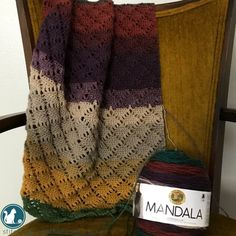 Free pattern to make this gorgeous crochet wrap. Simple to make and works as a cozy scarf. Made in Mandala Yarn the colors make the perfect shawl for fall.