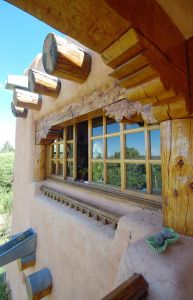 It takes a while to absorb and understand the scale of Thom's adobe house and studio in Taos, New Mexico. If at first glance from the outside it looks like an ancient castle, with its large tall en...