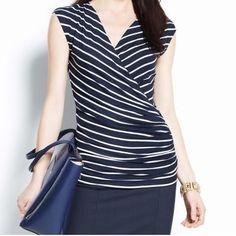 Ann Taylor striped wrap top NWOT Ann Taylor navy / white striped faux wrap top there is a little clip closure on the neck also . Starch jersey kinda fabric. NWOT Ann Taylor Tops