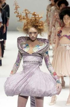 Far East flavour: McQueen looked to Eastern influences for spring/summer 2005. The impressive Chinese garden cork is by Philip Treacy, the famous milliner, and long-time McQueen collaborator.