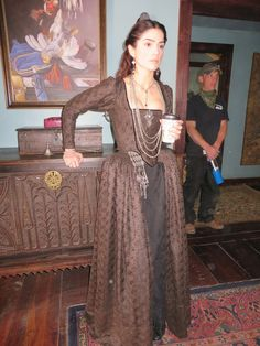 Janet Montgomery between takes. Brown and black silk brocade dress from season one.  She  has never worn the same dress twice.  I always try and give the audience something new to look at with my female characters..