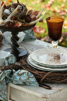 woodland tablescape --- just fell in love! Love how they tie in the antlers :)