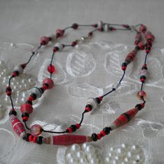 Knotted bead jewelry: She uses tweezers to carefully place the knots to secure the beads in place.