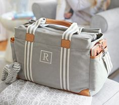 A diaper bag or nappy bag is a storage bag with many pocket-like spaces that is big enough to carry everything needed by someone taking care of a baby while taking a typical short outing. Chic Diaper Bag, Boy Diaper Bags, Diaper Bag Backpack, Best Diaper Bag, Shower Bebe, Baby Gadgets, Baby Necessities, Baby Must Haves, Baby Essentials
