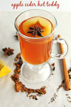 This whiskey apple cider hot toddy is perfect for those cold nights! Get cozy, and enjoy this cocktail with apple cider tea, whiskey, honey, and lemon. Warm Cocktails, Apple Cocktails, Fall Drinks, Holiday Cocktails, Classic Cocktails, Mixed Drinks, Apple Cider Hot Toddy, Spiked Apple Cider, Whisky Cocktail