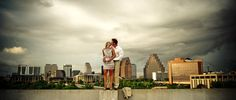 Take a couples photo in front of the Austin skyline.