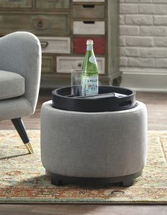Small but mighty, the Menga ottoman with storage can be a big help when you're tight on space. Flip top goes from a cushioned seat to a table surface/serving tray with cutout handles. Round design beautifully goes with the flow.