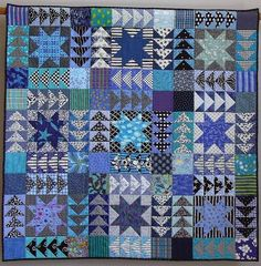 Quilt made from the sawtooth star quilt block and flying geese quilt blocks