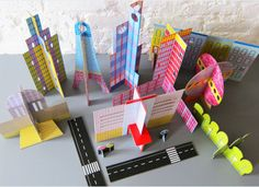 Slot construction buildings by Laura Ljungkvist http://illustrationsavestheday.com/category/sightings/ Could have students create their own for an architecture and 3-D lesson. Make a class town with all the dream houses out of recycled materials? Could lead into a photographer lesson or a sculpture lesson based on where I want to take it