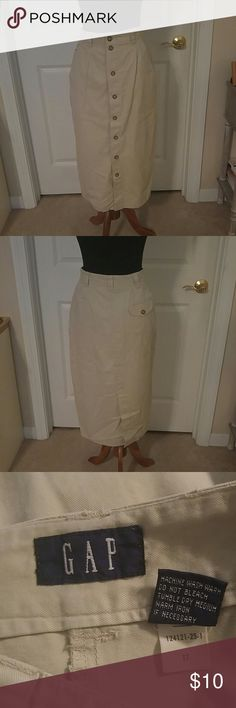 "Khaki Button Front Midi Skirt Very cute skirt from the Gap. In excellent condition but I would suggest reinforcing the buttons.  You know how the factories sew on buttons.   Size 6. 28"" waist, 31"" long 2 side pockets, 1 back flap pocket. 11"" back slit Button Front. Belt loops. GAP Skirts Midi"